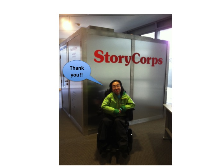 """Asian American woman in a wheelchair in front of a StoryCorps recording booth. A blue caption bubble says, """"Thank you!"""""""