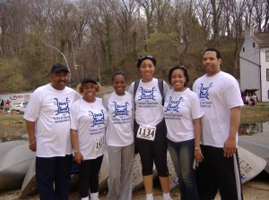 Photo of six African American men and women standing in a row wearing t-shirts from a fundraising walk for the Martin Multiple Sclerosis Alliance Foundation