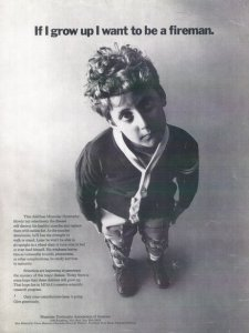 """Black and white photo of an ad featuring Ben Mattlin as a young boy for the Muscular Dystrophy Foundation. He is looking pensively at the camera and is about 7-8 years old. The text at the top of the image says, """"If I grow up I want to be a fireman."""""""