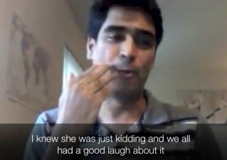 """Photo of a South Asian man using sign language. The caption at the bottom of the image reads """"I knew she was just kidding and we all had a good laugh about it"""""""
