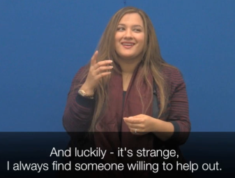 "A South Asian woman using sign language. Below is a caption: ""And luckily, it's strange, I always find someone willing to help out.'"