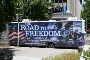 """A large bus that says, """"The Road to Freedom"""""""