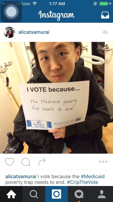 "Screenshot of a recent Instagram post by user alicatsamurai showing a photo of an Asian American woman in a wheelchair holding a white piece of paper that says, ""I Vote because...the Medicaid poverty trap needs to end."" The caption below the message has the same text in the sign."