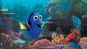 "An animated scene from the Pixar film ""Finding Dory."" Dory, the central character who is a blue tang, in an underwater coral reef."