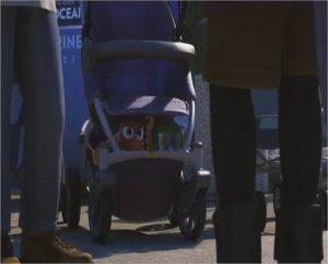 "An animated scene from the Pixar film ""Finding Dory."" An image of a outdoor crowd with a baby stroller with an octopus and a sippy cup with a blue fish inside."