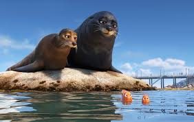 "An animated scene from the Pixar film ""Finding Dory."" Two sea lions on a rock talking to two small clownfish."