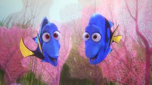"An animated scene from the Pixar film ""Finding Dory."" Underwater coral reef in the background with two royal blue tang fish"
